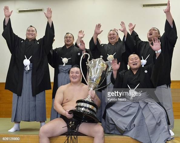 TOKYO Japan Yokozuna Hakuho holds the Emperor's Cup after winning the Autumn Grand Sumo Tournament at Ryogoku Kokugikan in Tokyo on Sept 29 2013...
