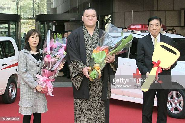 TOKYO Japan Yokozuna Hakuho presents a blooddonation vehicle to the Japanese Red Cross Society in Tokyo on Feb 21 taking over the role played by the...