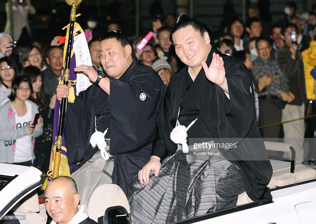 FUKUOKA Japan Yokozuna Hakuho waves during a parade after winning the 15day Kyushu Grand Sumo Tournament in Fukuoka on Nov 27 2011 with a 141 record