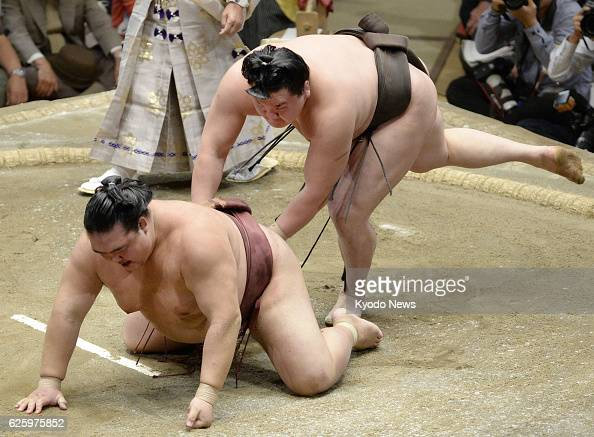 TOKYO Japan Yokozuna Hakuho wrestles down Kisenosato to capture his 27th career title with a day to spare at the Autumn Grand Sumo Tournament in...