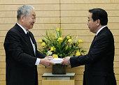TOKYO Japan Yotaro Hatamura a professor emeritus at the University of Tokyo hands a report to Prime Minister Yoshihiko Noda at the premier's office...