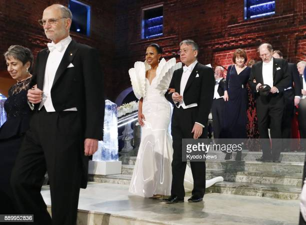 Japanborn British novelist Kazuo Ishiguro enters a Stockholm City Hall room to attend a banquet sponsored by Sweden's King Carl XVI Gustaf for the...