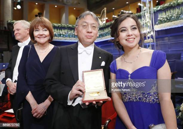 Japanborn British novelist Kazuo Ishiguro holds the 2017 Nobel Prize in literature medal after receiving it from Sweden's King Carl XVI Gustaf at a...