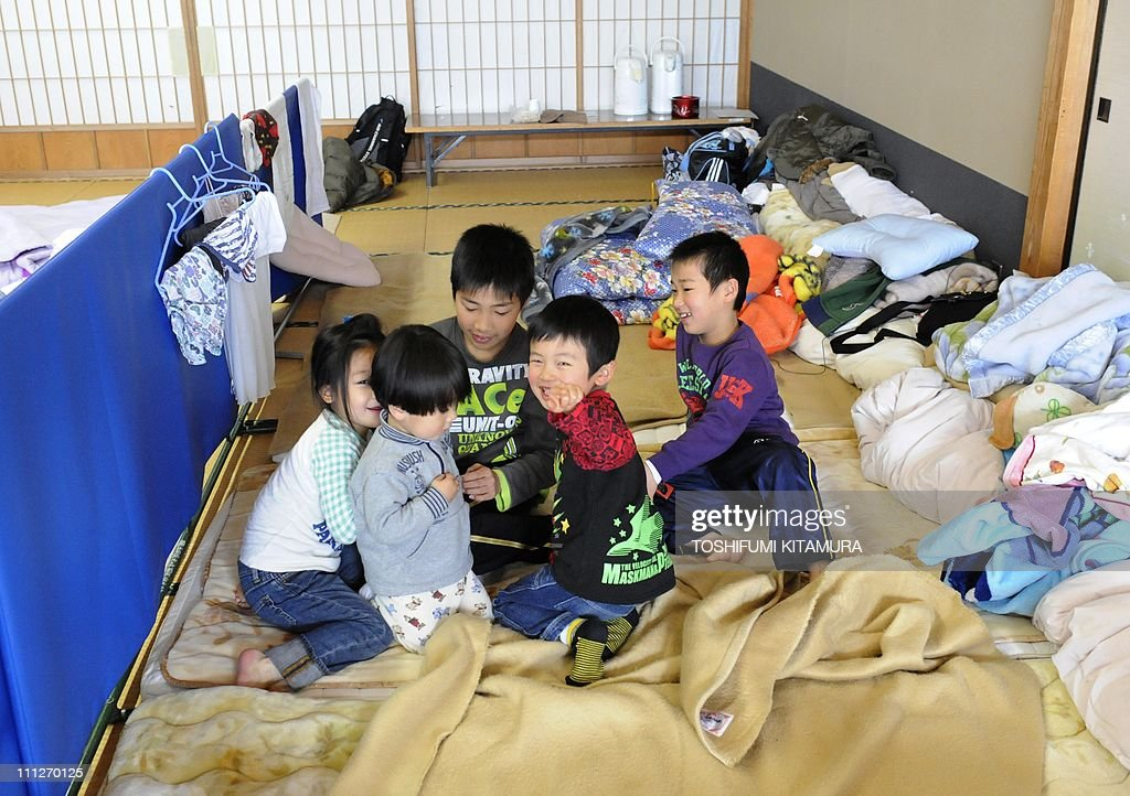 STORY 'Japan-disaster-nuclear-refugee,FOCUS' by Shingo ItoThis picture taken on March 28, 2011 shows children who were evacuated from Fukushima playing together at their makeshift shelter in Yokote city, Akita prefecture. Refugees who fled Japan's tsunami-hit nuclear reactors say they have been betrayed by the company that runs them, accusing embattled operator TEPCO of creating a 'man-made disaster'. Tens of thousands of people left their homes near the Fukushima Daiichi nuclear plant after it was crippled by the massive quake and tsunami that hit Japan on March 11, washing away whole towns.