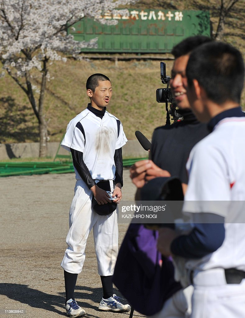 STORY 'Japan-disaster-quake-tsunami-school-baseball' Harumi OzawaThis picture taken on April 28, 2011 shows Yuki Kikuchi (L), who is a member of the baseball club at Yamada High School, speaking in an interview after a training session in Yamada, Iwate prefecture. Kikuchi saw his hometown destroyed by the tsunami which devastated northeastern Japan on March 11, and the teenager thought his dream of playing baseball was gone. Now living in a school gymnasium with hundreds of other disaster victims, the 17-year-old believed his chance of making the national high school baseball tournament had been snatched away by huge waves that left Yamadamachi in ruins. But the teenager said his team was now determined to show the disaster had not destroyed their hopes of playing at the Koshien Stadium, Japan's biggest ball park where the legendary Babe Ruth played an exhibition game in 1934. AFP PHOTO / KAZUHIRO NOGI