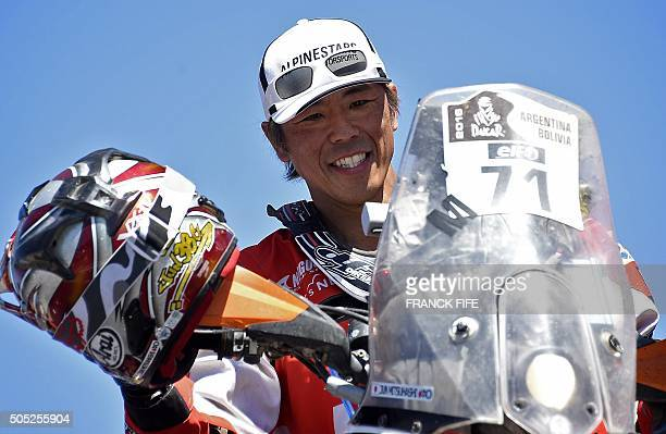 Japane Jun Mitsuhashi poses on the podium after the Stage 13 of the Dakar 2016 between Villa Carlos Paz and Rosario Argentina on January 16 2016...