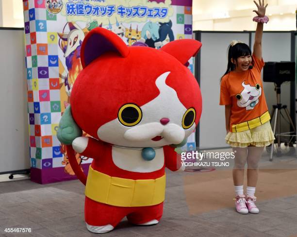JapanentertainmentgamestoyFOCUS by Miwa Suzuki This picture taken on August 12 2014 shows 'Jibanyan' main character of popular 'YoKai Watch' a nexus...