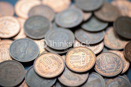 japanese 10 yen coins stock photo thinkstock