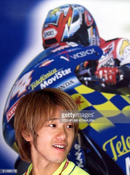 Japanese 250cc Grand Prix rider Daijiro Kato smiles in his pit prior to the second qualifying practice round of the Pacific Grand Prix at Twin Ring...
