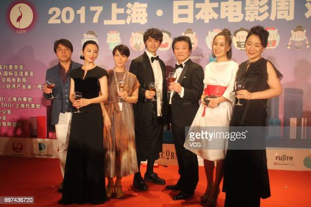 Japanese actor and model Takumi Saito Japanese actress Rena Tanaka attend the welcome banquet of Japan Film Week during the 20th Shanghai...