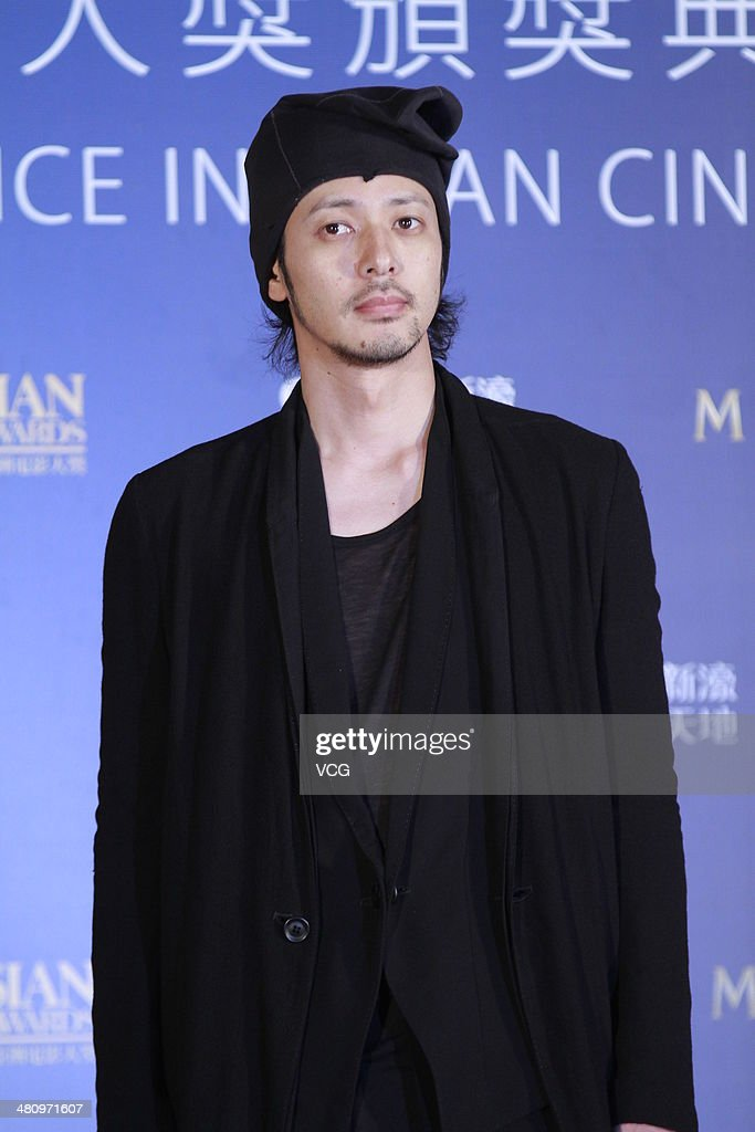 Japanese actor <a gi-track='captionPersonalityLinkClicked' href=/galleries/search?phrase=Joe+Odagiri&family=editorial&specificpeople=3039079 ng-click='$event.stopPropagation()'>Joe Odagiri</a> attends red carpet of the The 8th Asia Film Award on March 27, 2014 in Macau, China.