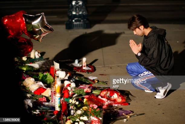 Japanese actor Keisho Taira brother of actress Airi Taira pays respects at a makeshift memorial for Grammywinning pop legend and actress Whitney...
