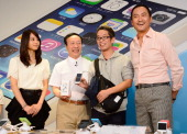 Japanese actor Ken Watanabe and actress Maki Horikita and President of Japan's biggest mobile carrier NTT Docomo Kaoru Kato pose with the first...