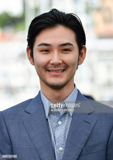 Japanese actor Ryuhei Matsuda poses on May 21 2017 during a photocall for the film 'Before We Vanish ' at the 70th edition of the Cannes Film...