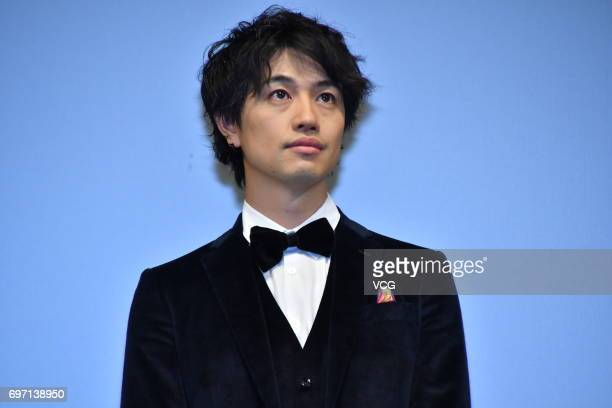 Japanese actor Takumi Saito attends the fans meeting of film 'Hirugao Love Affairs in the Afternoon' during the 20th Shanghai International Film...