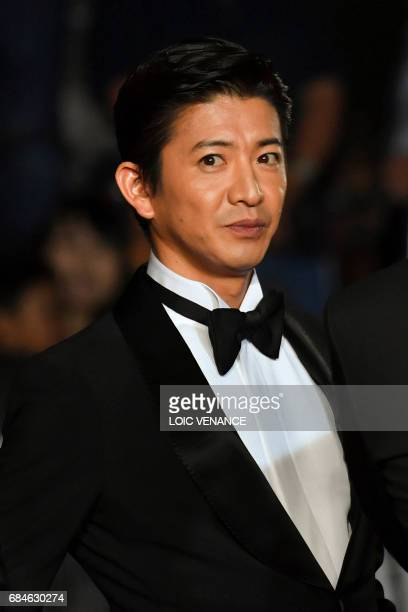 Japanese actor Takuya Kimura arrives on May 18 2017 for the screening of the film 'Blade of the Immortal' at the 70th edition of the Cannes Film...