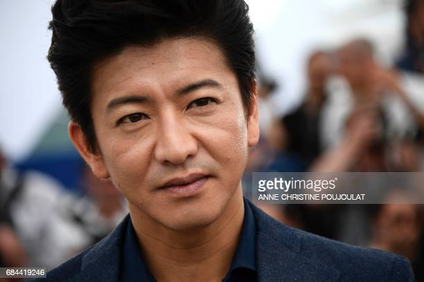 Japanese actor Takuya Kimura poses on May 18 2017 during photocall for the film 'Blade of the Immortal' at the 70th edition of the Cannes Film...