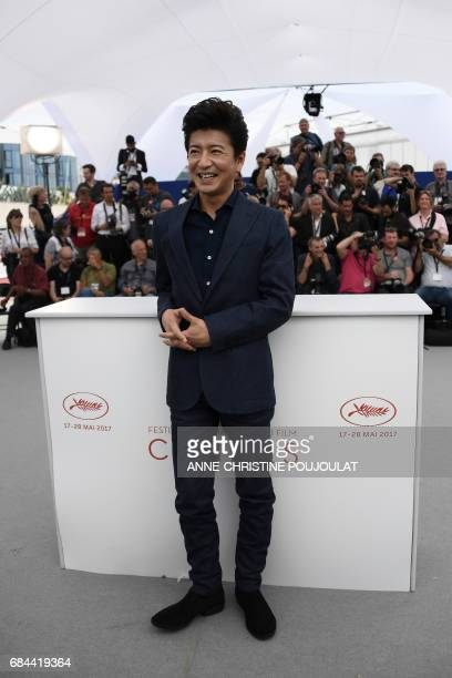 Japanese actor Takuya Kimura smiles on May 18 2017 during photocall for the film 'Blade of the Immortal' at the 70th edition of the Cannes Film...