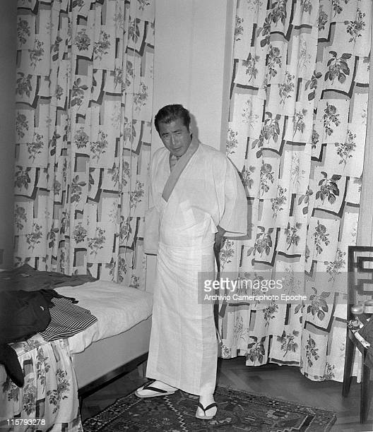 Japanese actor Toshiro Mifune wearing a hiyoku an underkimono in his hotel room during the Movie Festival Biennale September 1961