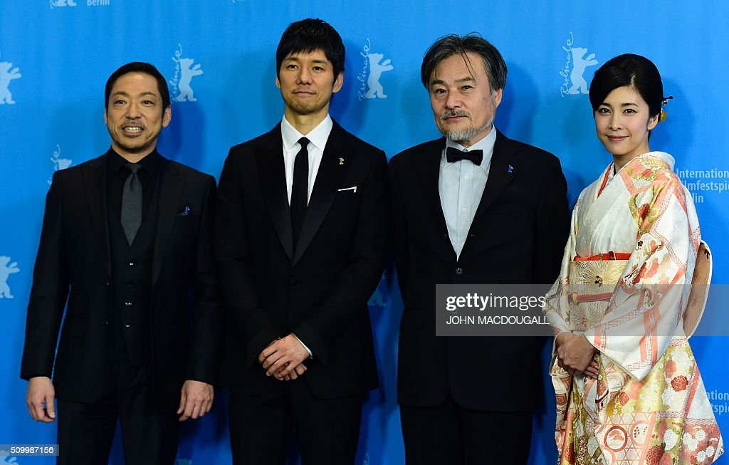 Japanese actors Teruyuki Kagawa and Hidetoshi Nishijima, director Kiyoshi Kurosawa and actress Yuko Takeuchi pose for photographers during the photocall for the film Creppy in the Berlinale Special category of the 66th Berlinale Film Festival in Berlin on February 13, 2016. / AFP / John MACDOUGALL