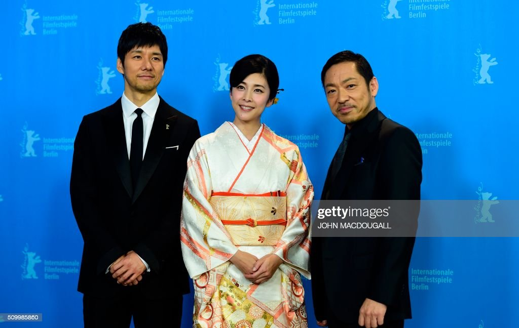 Japanese Actors Teruyuki Kagawa, Yuko Takeuchi and Hidetoshi Nishijima pose durring a photocall for the film 'Creepy' at the 66th Berlinale Film Festival in Berlin on February 13, 2016. / AFP / John MACDOUGALL