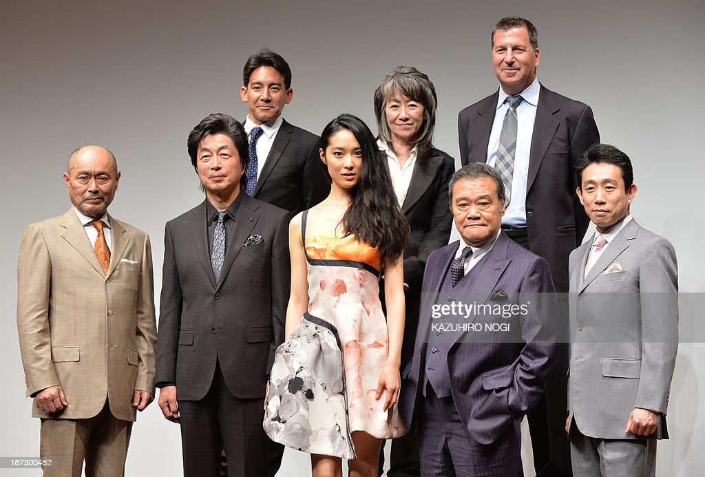 Japanese actress and actors, (front row L-R) Masatoh Ibu, Masatoshi Nakamura, Eriko Hatsune, Toshiyuki Nishida, Takataro Kataoka, and producers (top row L-R) Eugene Nomura, Yoko Narahashi and Gary Foster, pose in a photo session after a press conference to promote their new film 'Emperor' in Tokyo on April 24, 2013. The film will open in Japan on July 27.