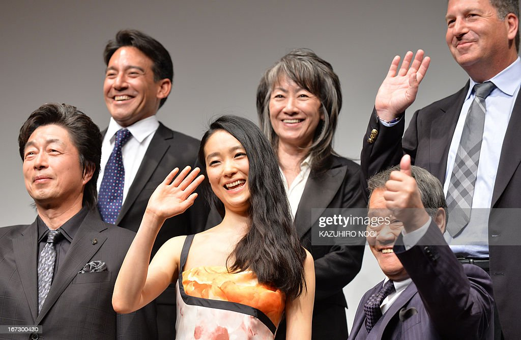 Japanese actress and actors (front row L-R) Masatoshi Nakamura, Eriko Hatsune, Toshiyuki Nishida and producers (top row L-R) Eugene Nomura, Yoko Narahashi and Gary Foster pose in a photo session after a press conference to promote their new film 'Emperor' in Tokyo on April 24, 2013. The film will open in Japan on July 27.