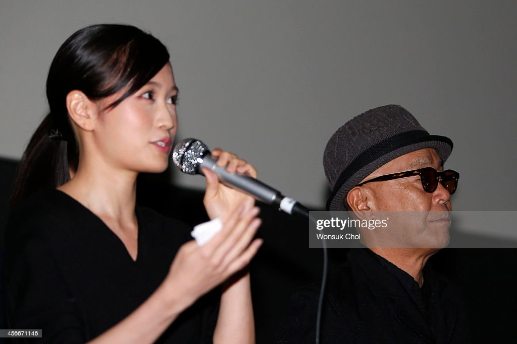 Japanese actress <a gi-track='captionPersonalityLinkClicked' href=/galleries/search?phrase=Atsuko+Maeda&family=editorial&specificpeople=6867932 ng-click='$event.stopPropagation()'>Atsuko Maeda</a> (L) and director Ryuichi Hiroki attend the stage greeting of the movie 'Kabukicho Love Hotel' on the fourth day of the 19th Busan International Film Festival (BIFF) at the Lotte Cinema Centum on October 5, 2014 in Busan, South Korea.