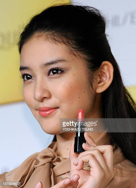 Japanese actress Emi Takei displays Japanese cosmetics company Shiseido's new glossy lipstick 'Maquillage True Rouge' in Tokyo on January 19 2012 AFP...