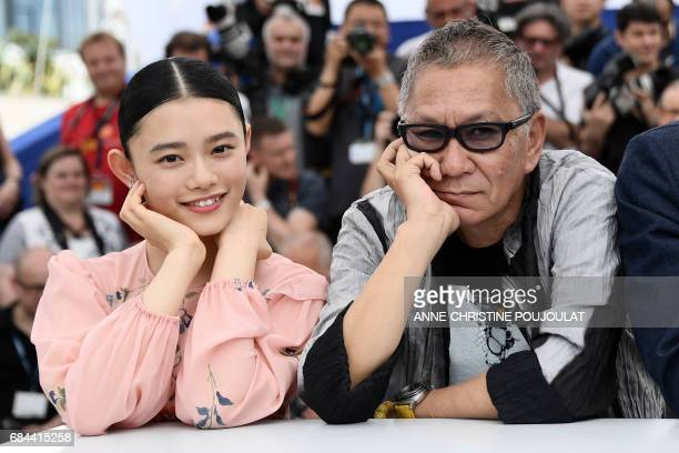 Japanese actress Hana Sugisaki and Japanese director Takashi Miike pose on May 18 2017 during a photocall for the film 'Blade of the Immortal' at the...