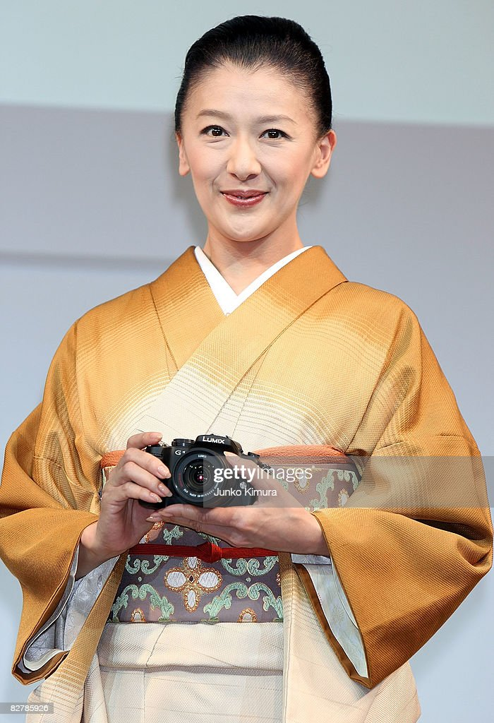 Japanese actress Kahori Torii introduces Matsushita Electric Industrial Co., Ltd's world's smallest new single-lens reflex camera Lumix G1 during a press conference at Izumi Garden Gallery on September 12, 2008 in Tokyo, Japan. The mirror-less structure of the body and the interchangeable lens, the camera is the smallest and lightest in the cameras equipped interchangeable lens and free-angle LCD screen. The weight of the body is less than 400 grams.