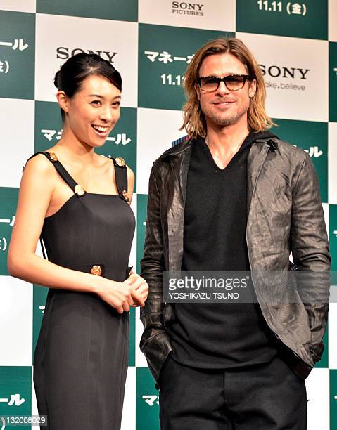 Japanese actress Kazue Fukiishi and US actor Brad Pitt attend a press conference for his latest movie 'Moneyball' in Tokyo on November 10 2011 The...