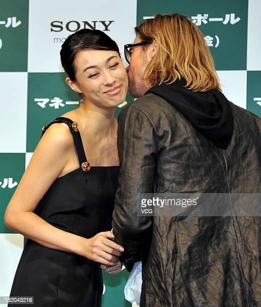Japanese actress Kazue Fukiishi and US actor Brad Pitt attend the press conference for the film 'Moneyball' on November 9 2011 in Tokyo Japan