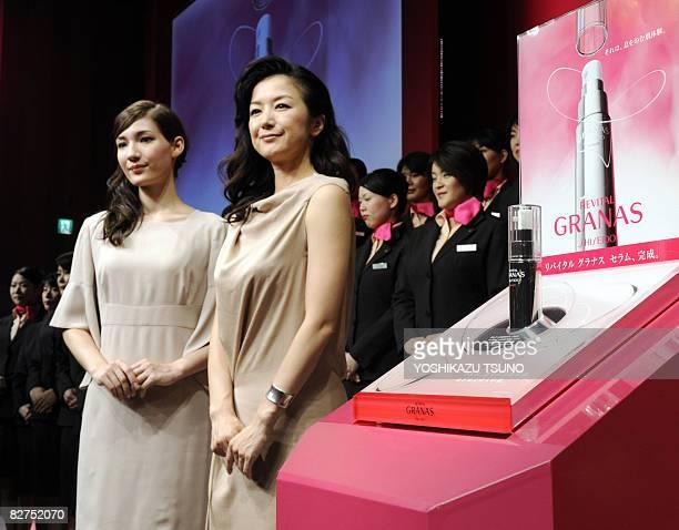 Japanese actress Kyoka Suzuki and Maiko display the beauty serum of Japanese cosmetics giant Shiseido's new brand 'Revital Granas' in Tokyo on...