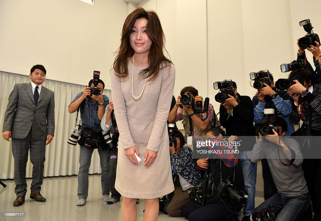 Japanese actress Noriko Sakai, well known in Asia especially in China, who was convicted of illegal drug use in 2009, bows as she leaves a press conference in Tokyo on November 24, 2012. Sakai will return to the stage 'Rhapsody of Azure Sky' in Tokyo on Decmber 15 after the expiration of her suspended sentence. AFP PHOTO / Yoshikazu TSUNO