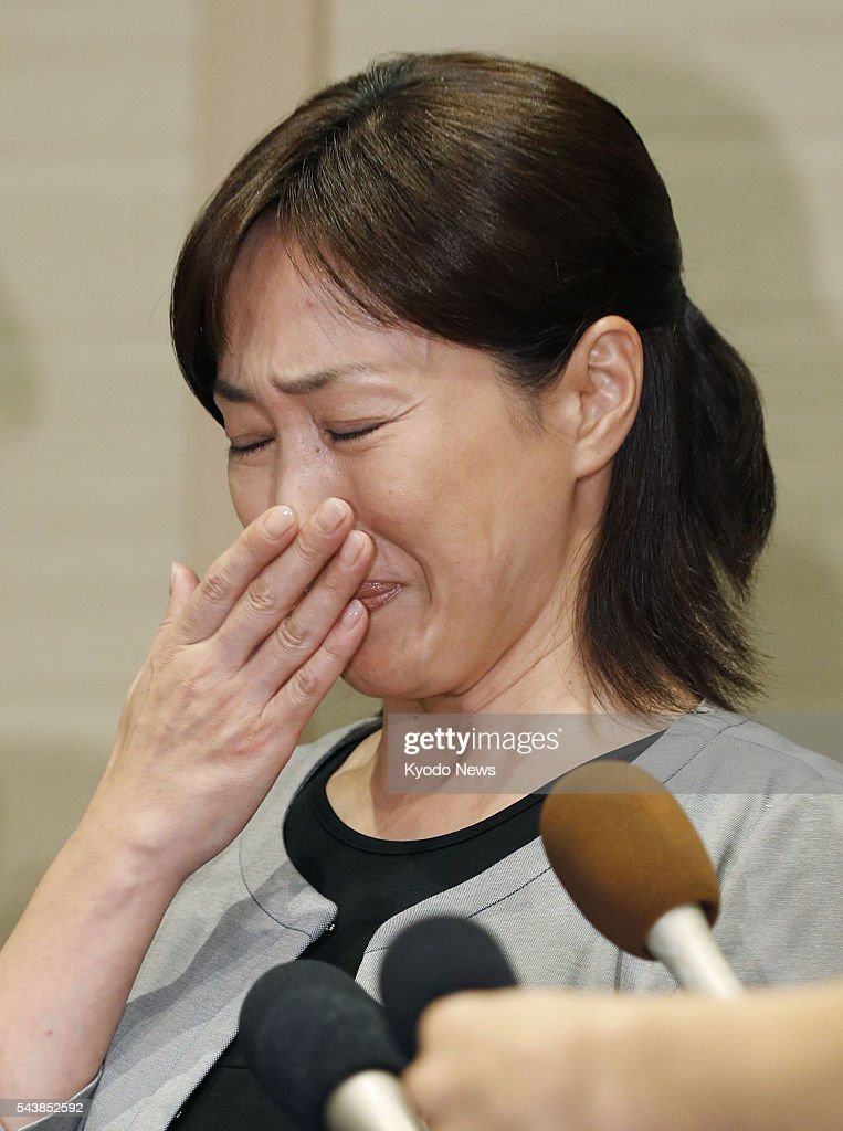 Japanese actress Reiko Takashima weeps as she speaks to reporters in Kyoto, western Japan, on June 30, 2016, about the arrest of her husband Noboru Takachi, a former actor, on suspicion of possessing stimulant drugs and marijuana.