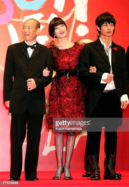 Japanese actress Rie Miyazawa poses with Kenki Saegusa Ryo Kase on the Stage during day one of the 20th Tokyo International Film Festival at Roppongi...