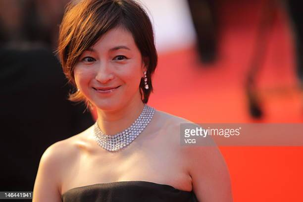 Japanese actress Ryoko Hirosue arrives at the red carpet during the opening ceremony for the 15th Shanghai International Film Festival at Shanghai...