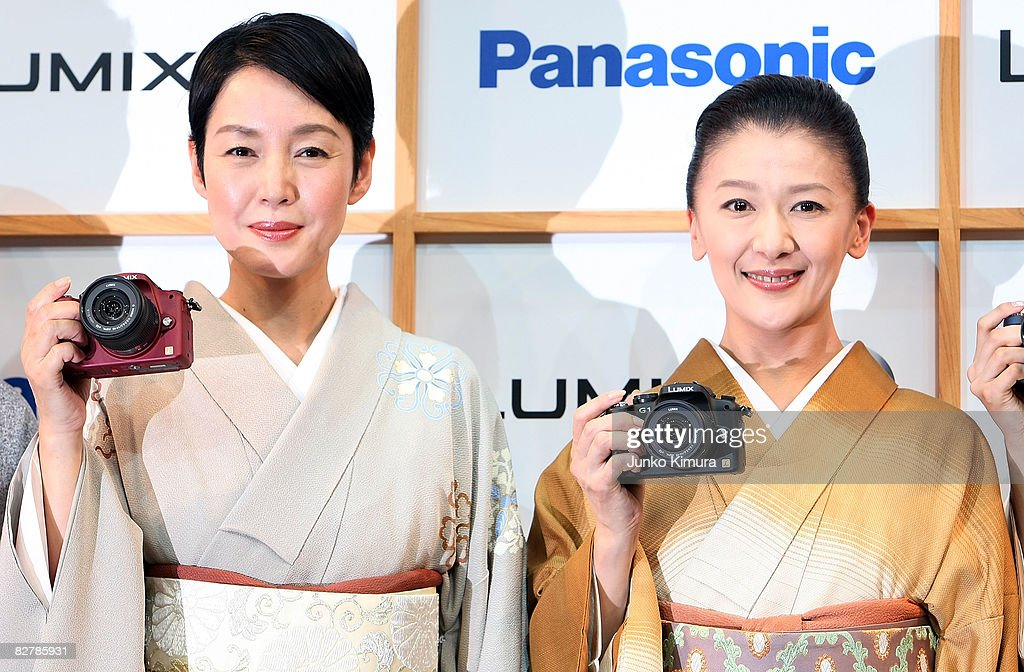 Japanese actresses Kanako Higuchi (L) and Kahori Torii (R) introduce Matsushita Electric Industrial Co., Ltd's world's smallest new single-lens reflex camera Lumix G1 during a press conference at Izumi Garden Gallery on September 12, 2008 in Tokyo, Japan. The mirror-less structure of the body and the interchangeable lens, the camera is the smallest and lightest in the cameras equipped interchangeable lens and free-angle LCD screen. The weight of the body is less than 400 grams.