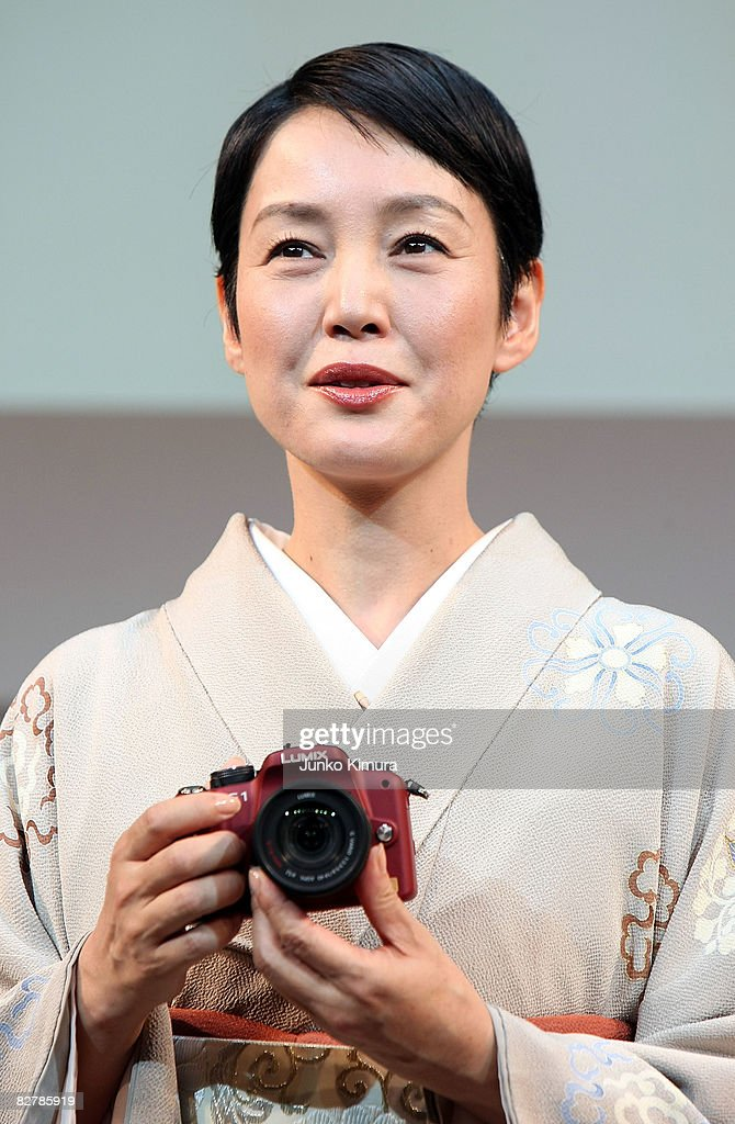 Japanese actresses <a gi-track='captionPersonalityLinkClicked' href=/galleries/search?phrase=Kanako+Higuchi&family=editorial&specificpeople=5367984 ng-click='$event.stopPropagation()'>Kanako Higuchi</a> introduces Matsushita Electric Industrial Co., Ltd's world's smallest new single-lens reflex camera Lumix G1 during a press conference at Izumi Garden Gallery on September 12, 2008 in Tokyo, Japan. The mirror-less structure of the body and the interchangeable lens, the camera is the smallest and lightest in the cameras equipped interchangeable lens and free-angle LCD screen. The weight of the body is less than 400 grams.