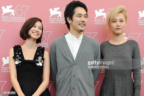 Japanese actresses Kiko Mizuhara Rinko Kikuchi and Japanese actor Kenichi Matsuyama pose during the photocall of 'Norumei no mori ' at the 67th...