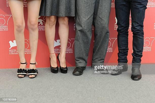 Japanese actresses Kiko Mizuhara Rinko Kikuchi Japanese actor Kenichi Matsuyama and French film director Tran Anh Hung pose during the photocall of...