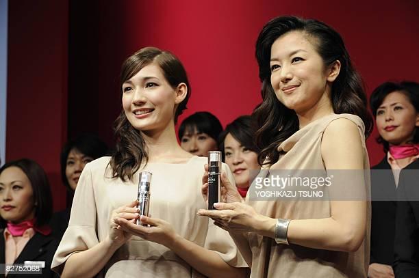 Japanese actresses Kyoka Suzuki and Maiko display the beauty serum of Japanese cosmetics giant Shiseido's new brand 'Revital Granas' in Tokyo on...