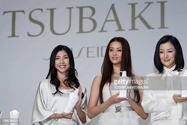 Japanese actresses Yuko Takeuchi Arisa Mizuki and Kyoka Suzuki display Shiseido's latest 'haircare' shampoo 'Tsubaki Golden Repair' during its models...