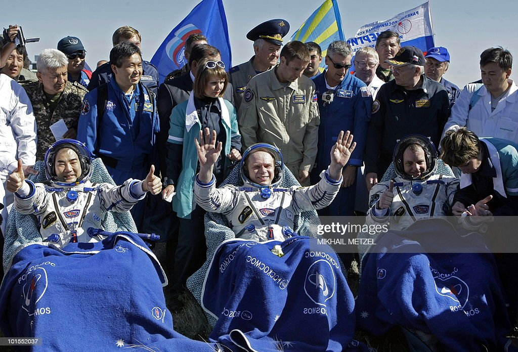 Japanese Aerospace Exploration Agency astronaut Soichi Noguchi (L), Russian cosmonaut Oleg Kotov (C), and US astronaut Timothy Creamer (R) are seen shortly after landing in the Russian Soyuz TMA-17 space capsule about 150 km (80 miles) south-east of the Kazakh town of Dzhezkazgan on June 2, 2010. The Soyuz capsule, which carried the three astronauts safely returned to Earth after a half-year stint on the international space station, with a landing in the Kazakh steppe.