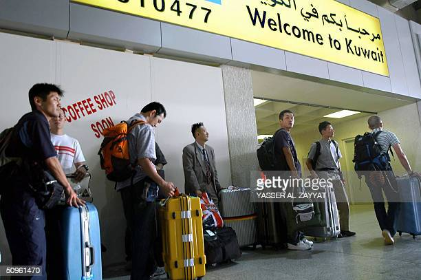 Japanese Air Self Defense Force soldiers arrive at Kuwait international airport 15 June 2004 The troops will head for southern Iraq to take part in...