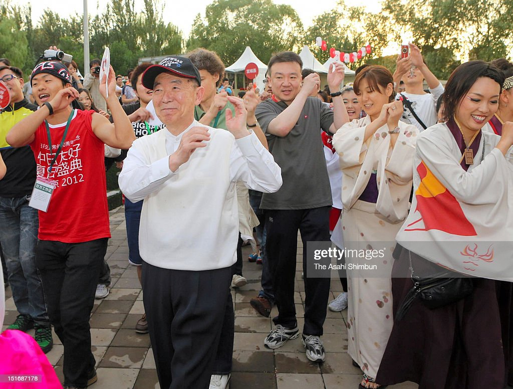 Japanese Ambassador to China Uichiro Niwa joins the Summer festival Obon dance to celebrate the 40th anniversary of Sino-Japanese ties re-establishment on September 2, 2012 in Beijing, China.