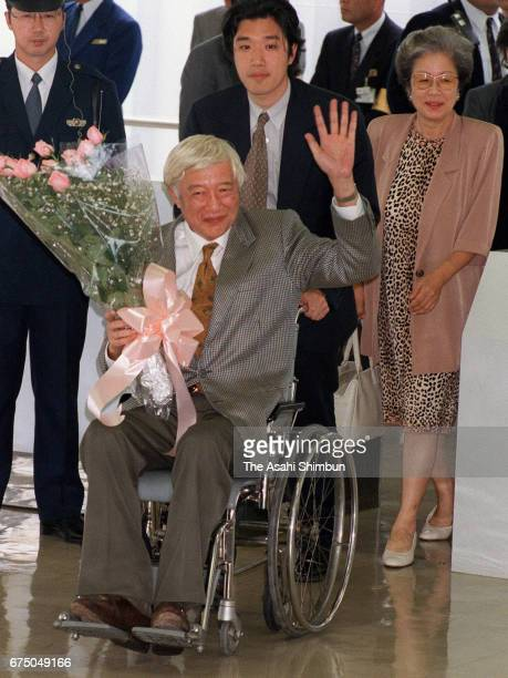 Japanese Ambassador to Peru Morihisa Aoki waves on arrival at Haneda International Airport after the hostage crisis on April 28 1997 in Tokyo Japan