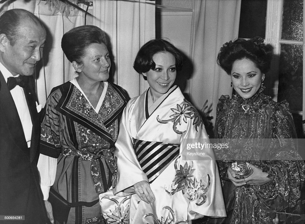 Japanese Ambassador to Vietnam and France Hideo Kitahara attends a revue at the Folies Bergere of 'Folie...Je T'Adore', France, 21st September 1977. L-R; Hideo Kitahara, Helene Martini, Noboru Kozuki, <a gi-track='captionPersonalityLinkClicked' href=/galleries/search?phrase=Dewi+Sukarno&family=editorial&specificpeople=4183132 ng-click='$event.stopPropagation()'>Dewi Sukarno</a>.