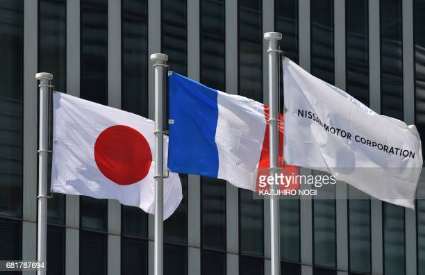 Japanese and French national flags and Nissan Motor Corporation flag are seen at Nissan Global Headquarters in Yokohama Kanagawa prefecture on May 11...
